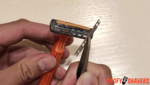 Remove the blade from the disposable razor