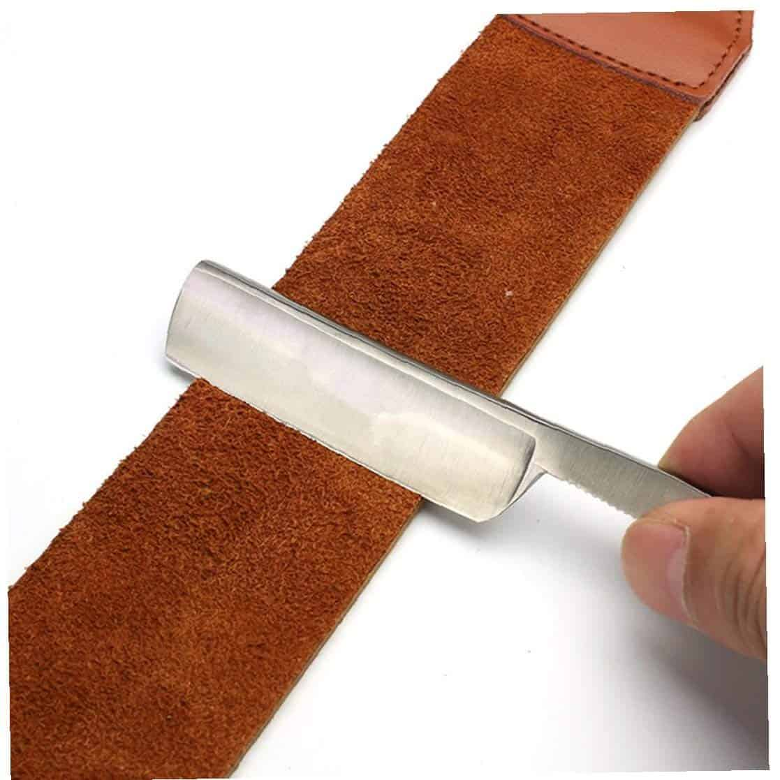 a straight razor with a belt